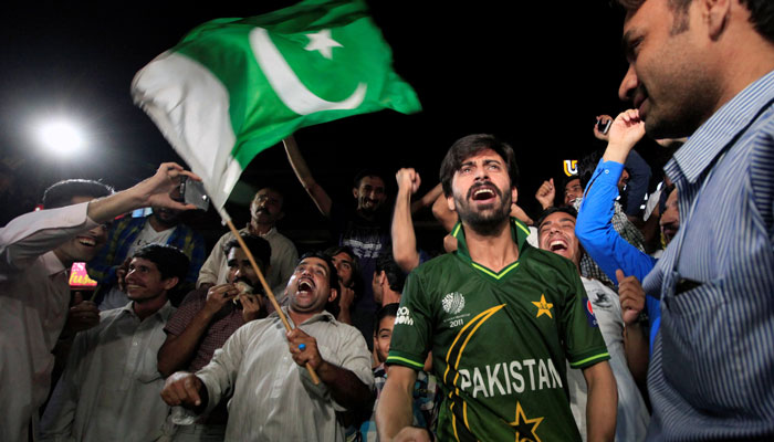 Pakistani cricket fans cheer as they watch on screen the Champions Trophy finals between India and Pakistan at London´s The Oval, in Islamabad