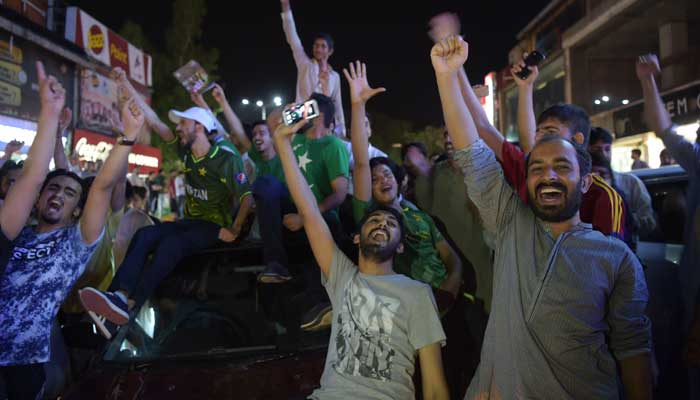 Pakistani cricket fans cheer after Pakistan defeated India in the Champions Trophy finals