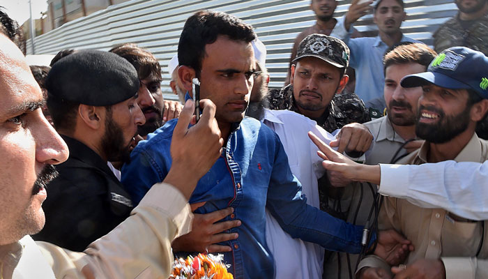 Ecstatic fans greet Player of the Final Fakhar Zaman upon his arrival in Peshawar/AFP