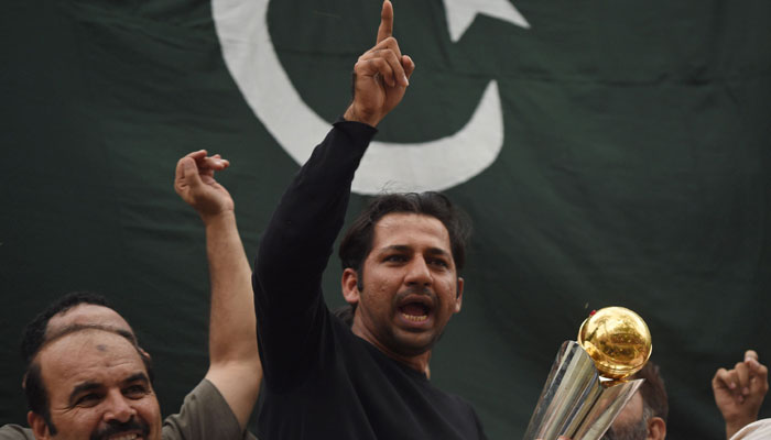 Sarfraz Ahmed gestures to fans after returning home to a hero's welcome/AFP