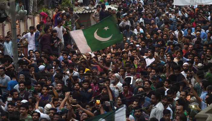 Fans throng Sarfraz Ahmed's residence in Karachi/AFP