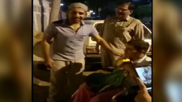 Sarfaraz gifts t-shirt to disabled fan outside house