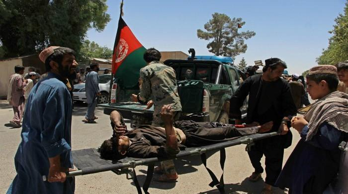 Taliban car bombing at Afghan bank kills 34, wounds dozens