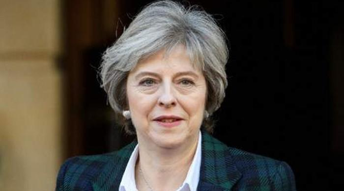 Britain´s May vows EU citizens can stay after Brexit
