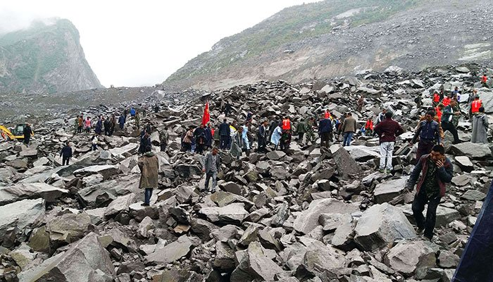 10 bodies found, 93 missing in China landslide