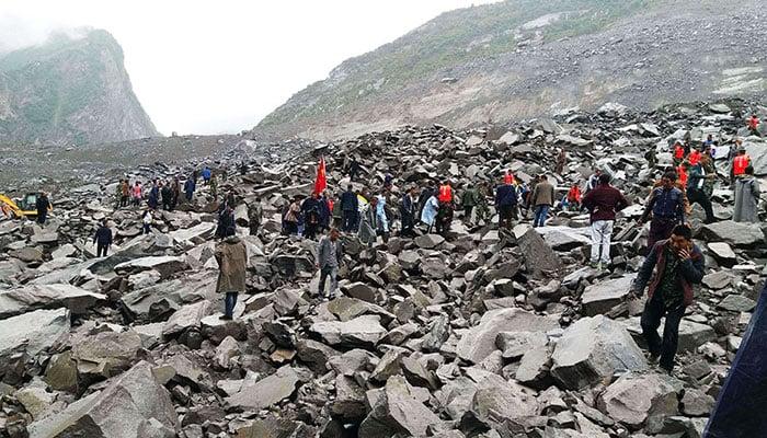 10 bodies found, scores missing in massive China landslide