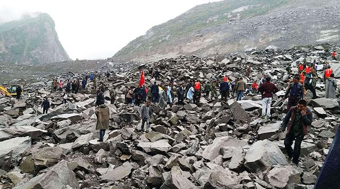Six dead, over 100 missing in China landslide