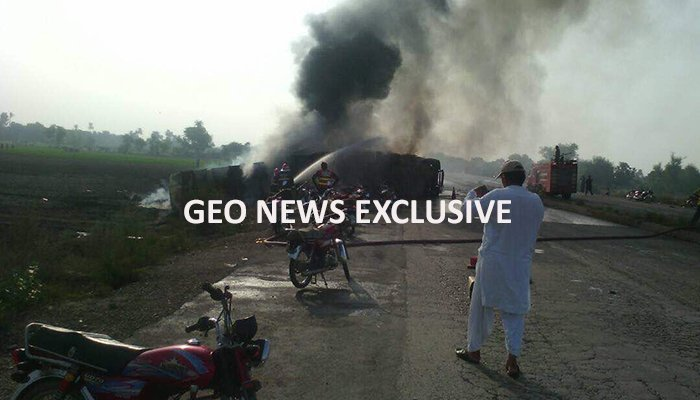Smoke billows from the oil tanker that caught fire on National Highway.