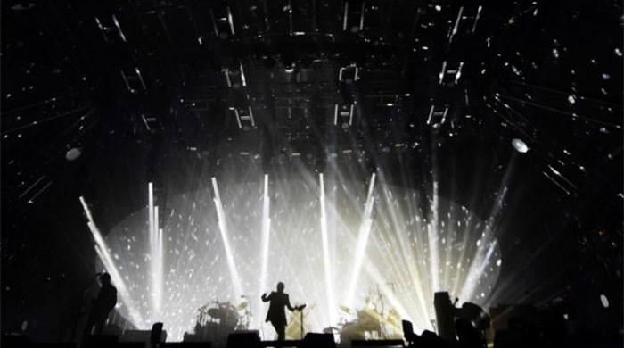 Radiohead take aim at 'strong and stable' May at Glastonbury