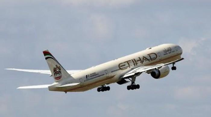 Etihad says passengers from US ban countries can board