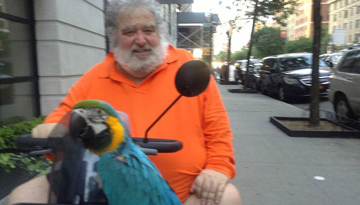 Blazer was famous for posing with his blue and green parrot