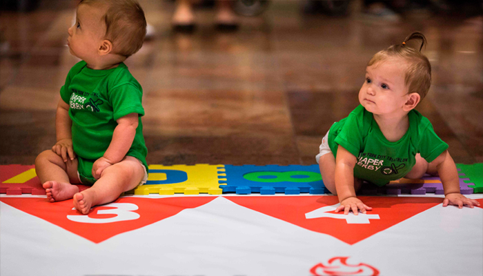 Two babies warm up before racing in the NYC Triathlon's annual Diaper Derby, July 14, 2017, in New York City. AFP/Dominick Reuter