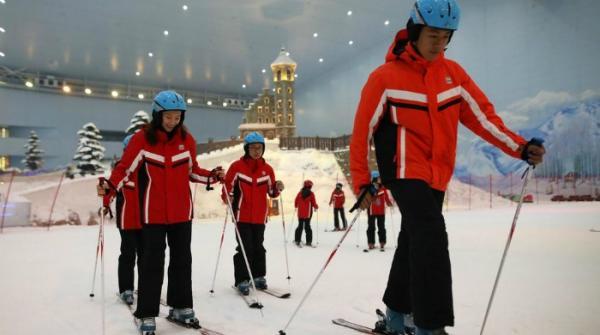 World's biggest indoor ski resort opens in China