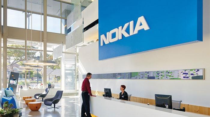 Nokia beats quarterly market forecasts but lowers networks outlook