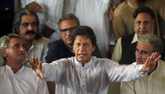 Pakistani opposition leader and head of the Pakistan Tehreek-i-Insaf (PTI) party, Imran Khan speaks during a press conference at his residence in Islamabad/ AFP