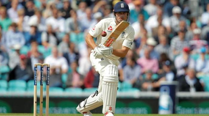 Cook stands firm for England in 100th Oval test