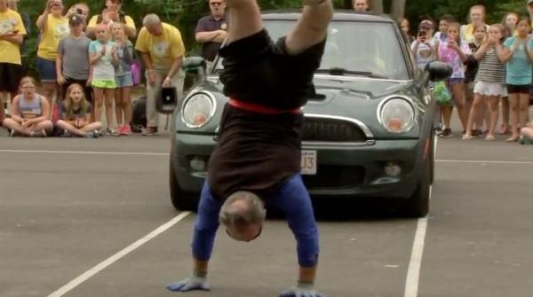 Elderly British man pulls car 16 feet while walking on hands