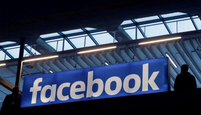 The Facebook logo is seen at a start-up companies gathering at Paris Station F France