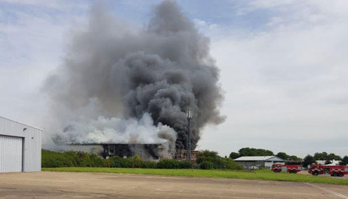 Hangar on fire by Southend Airport runway