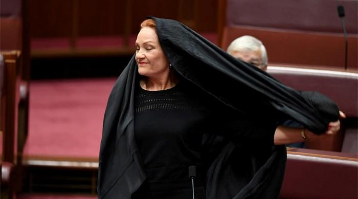Australia's Hanson wears burqa to parliament in bid to ban them