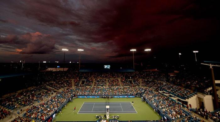 Tennis: Halep advances but Nadal, Pliskova postponed by rain