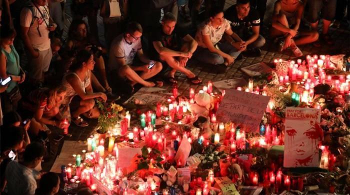 Barcelona van attacker may still be alive, on the run: police