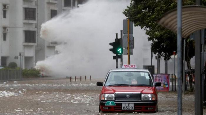 Typhoon batters Hong Kong, south China; streets flooded, flights canceled