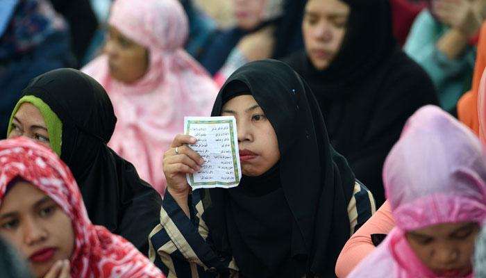Filipino Muslim women attend Eid-ul-Azha prayers in Manila on September 1, 2017/AFP