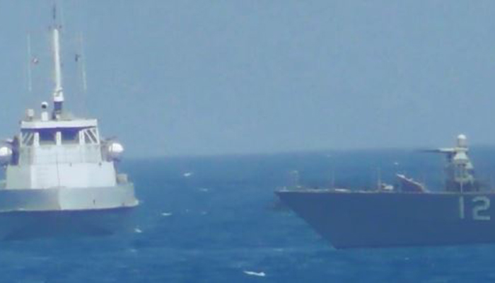 Iran's navy warns off U.S. warship in Sea of Oman