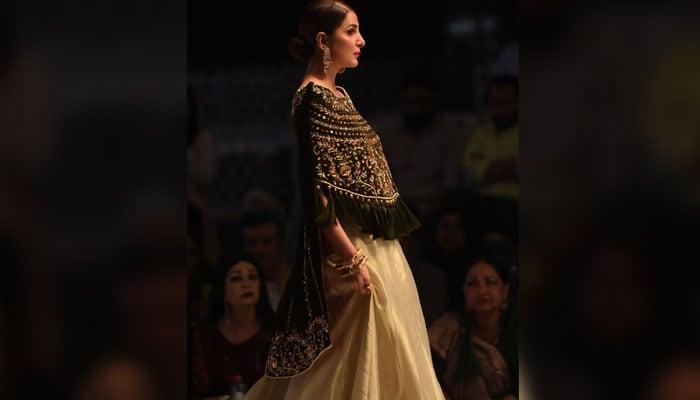 Model walks in designer Obaid Sheikh's creation. Photo: AFP