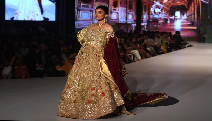 A model presents a dress by designer designer Erum Khan. Photo: AFP
