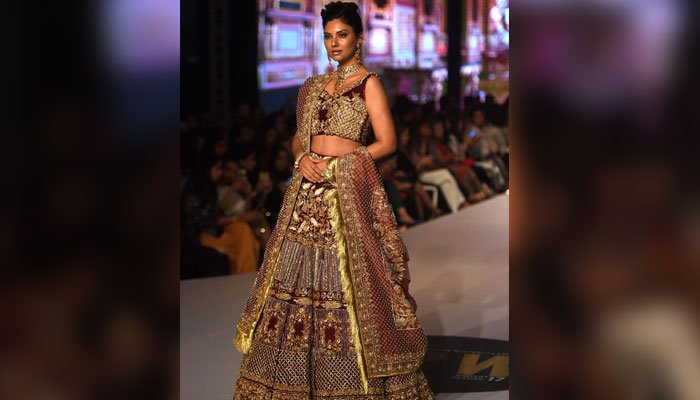 Model Sunita Marshal walks in ramp in a dress designed by Erum Khan. Photo: AFP
