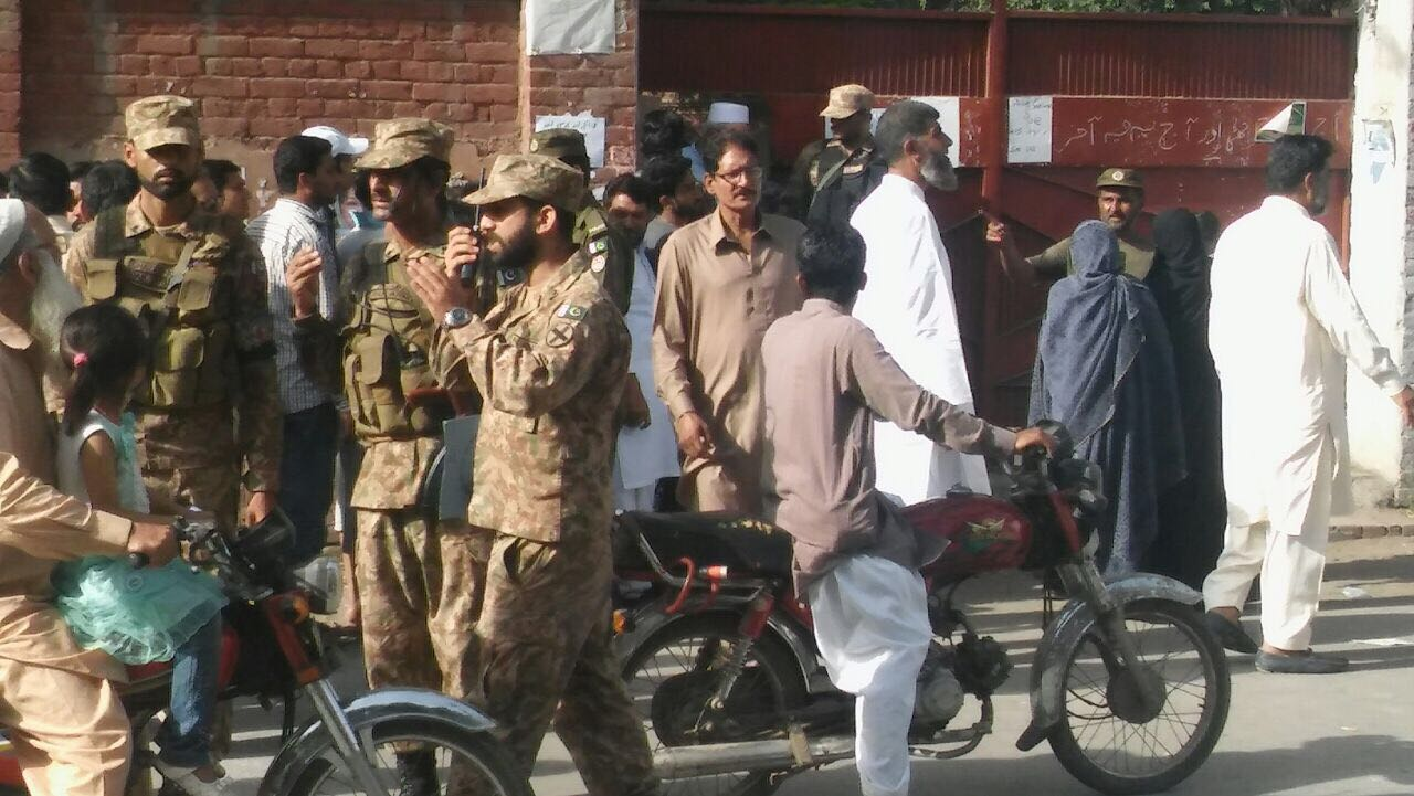 Army personnel outside a polling station. Photo: Geo News