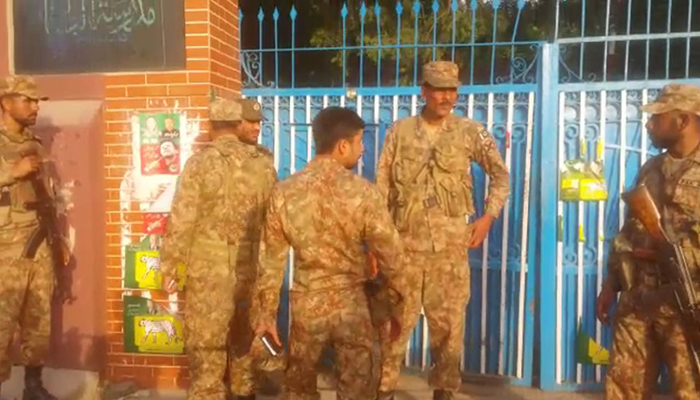 Army personnel stand alert at the polling station. Photo: Geo News