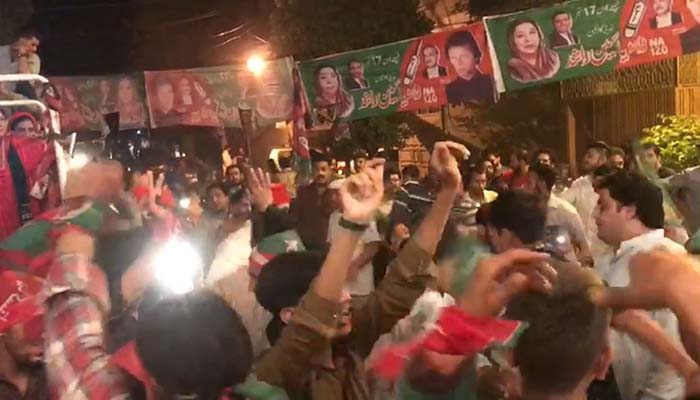 PTI supporters celebrate as results start pouring in. Photo: Geo News