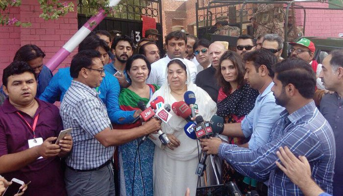 PTI Candidate Dr Yasmin Rashid speaking to media outside a polling station. Photo: Geo News
