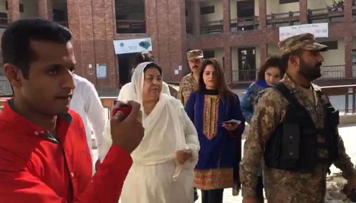 PTI candidate Dr Yasmin Rashid visiting a polling station. Source: Geo News