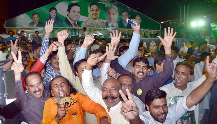 Supporters of Pakistan Muslim League-Nawaz dancing with joy in Mazung during by-elections in NA-120 constituency - Online
