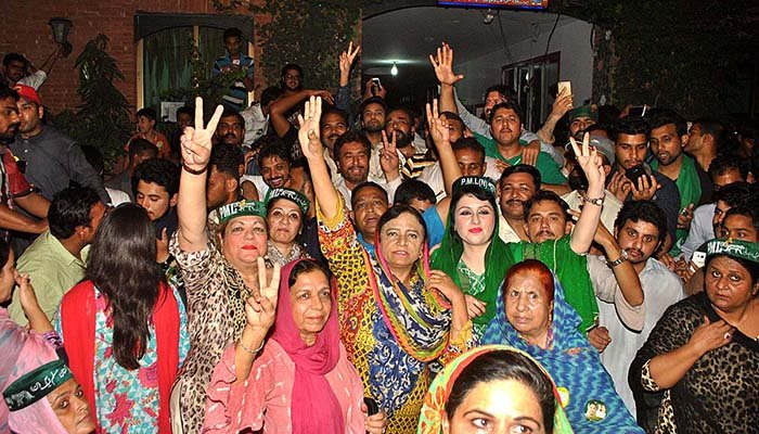 PML-N supporters celebrating the victory of PML-Ns candidate Kulsoom Nawaz after unofficial results of by-election in NA-120 - APP