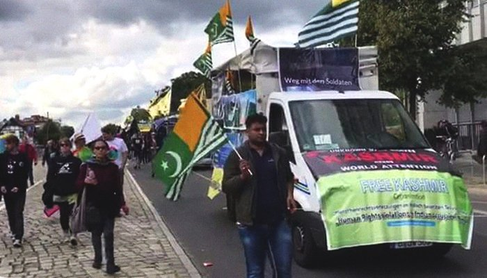 Participants can be seen carrying flags to protest racism, anti-Semitism, Islamophobia, and sexism beside the 'Kashmir Peace Truck' at the WelcomeUnited - CommUnity Carnival in Berlin, Germany, September 16, 2017. Geo.tv/Irfan Aftab