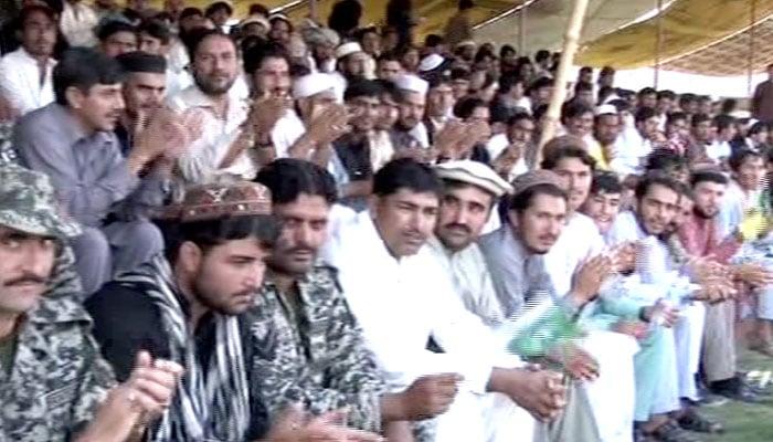 Locals enjoy the match between Pakistan XI and UK Media XI in Miranshah
