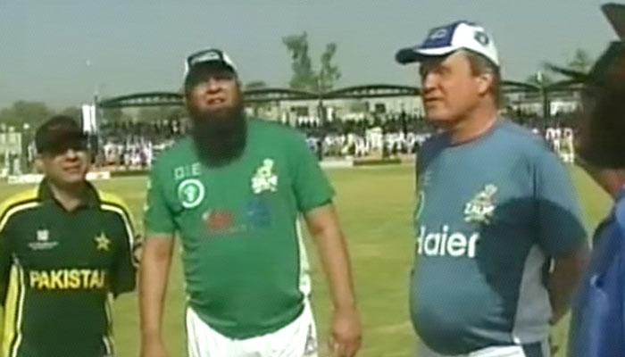 Pakistan XI captain Inzamam with UK Media XI skipper at toss