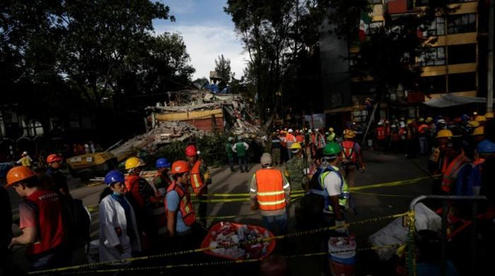 Tempers fray in desperate search for survivors days after Mexico quake