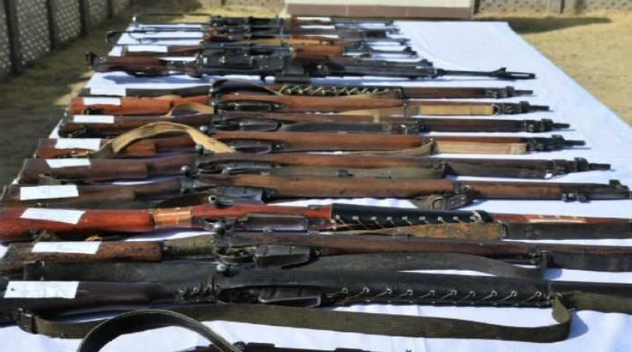 Police in Chiniot nab alleged terrorists, recover huge cache of weapons