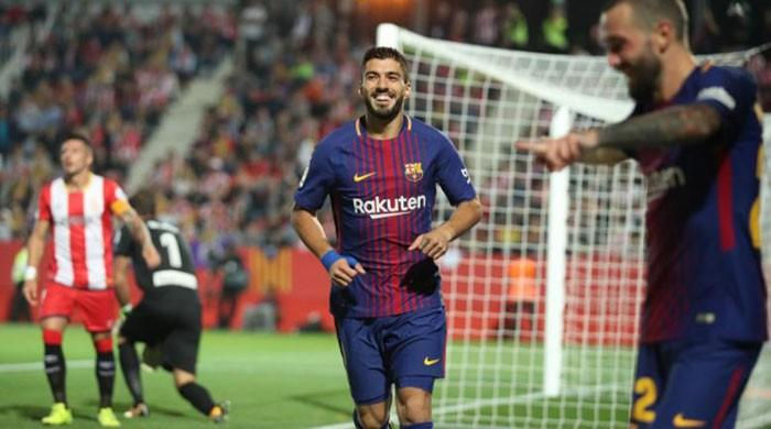 Suarez celebrates century game in style