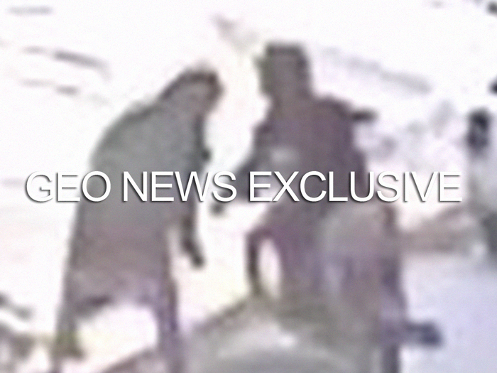 A screengrab — taken from the CCTV footage released by Karachi Police and obtained by Geo.tv — shows a woman, one of the victims, bending over after apparently being attacked by the knife-wielding suspect. Geo.tv via Geo News