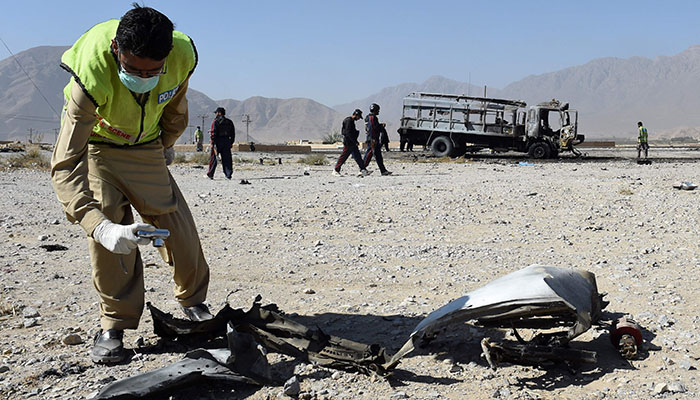 Pakistani investigators collect evidence after a suicide blast on the outskirts of Quetta on October 18, 2017- AFP