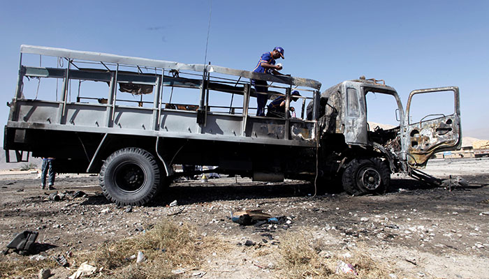 Rescue workers inspect a truck after a blast in Quetta - Reuters