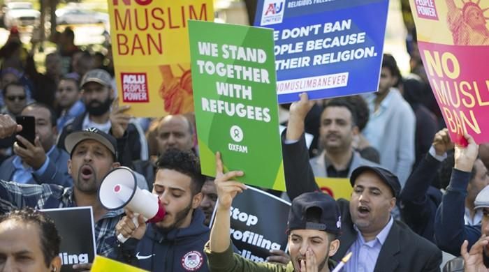 Second US judge orders freeze on Trump travel ban