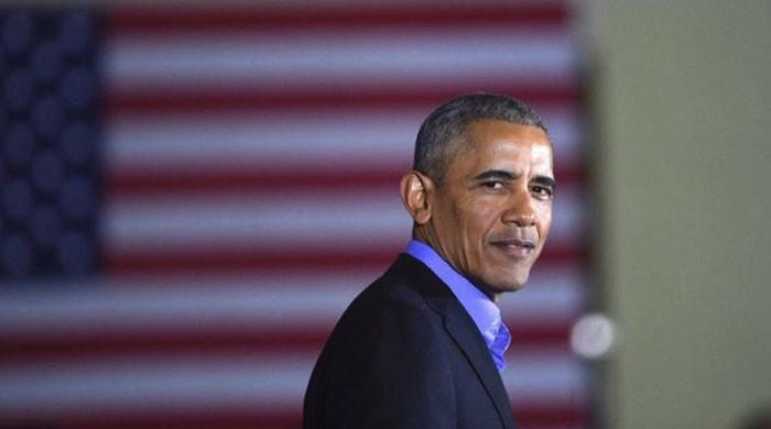 Obama slams 'politics of division' on return to campaign trail